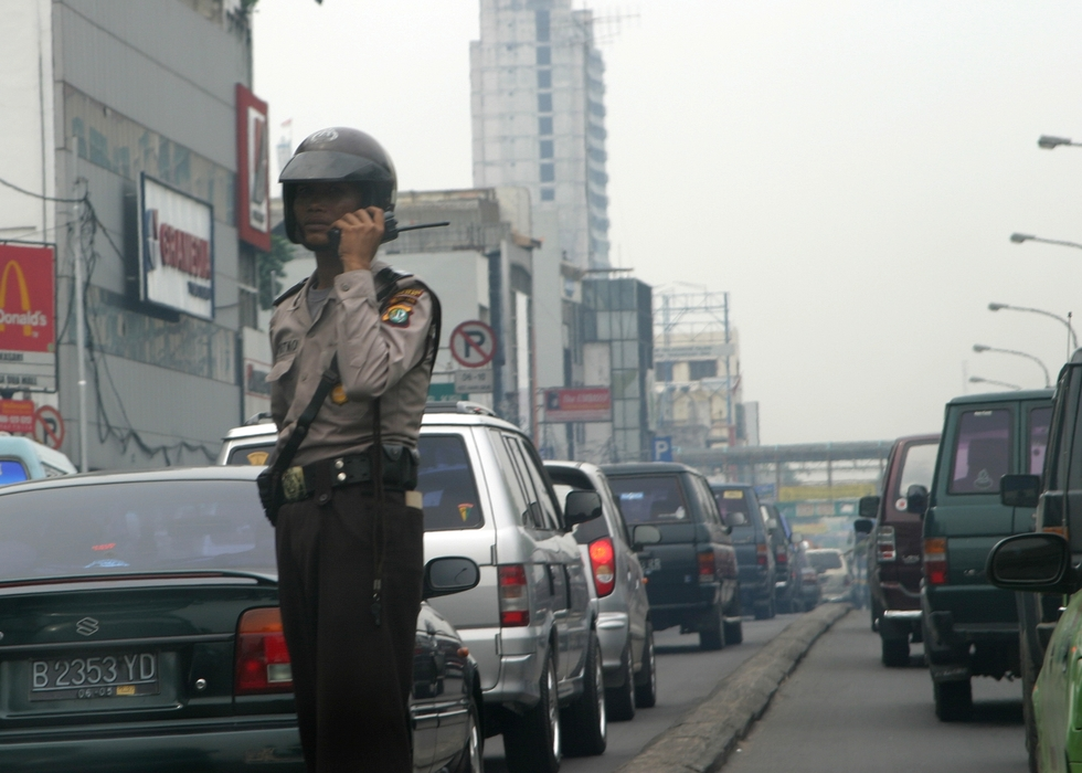 Traffic Cop in Busy Traffic, Bali, Indonesia