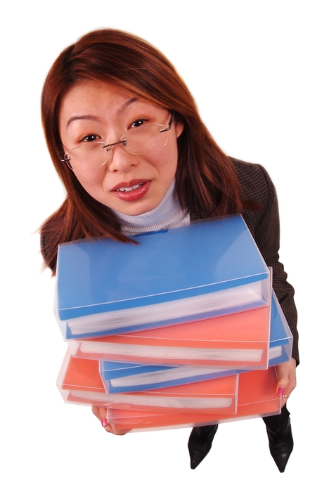 Businesswoman Holding Binders