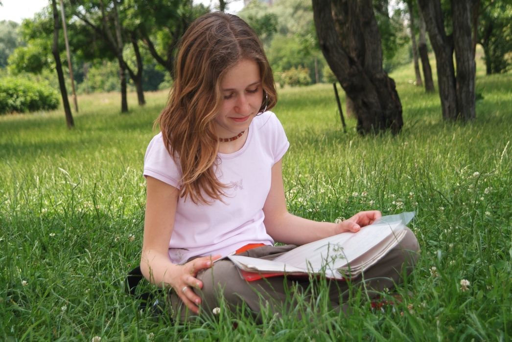 Girls Reading Book in the Park