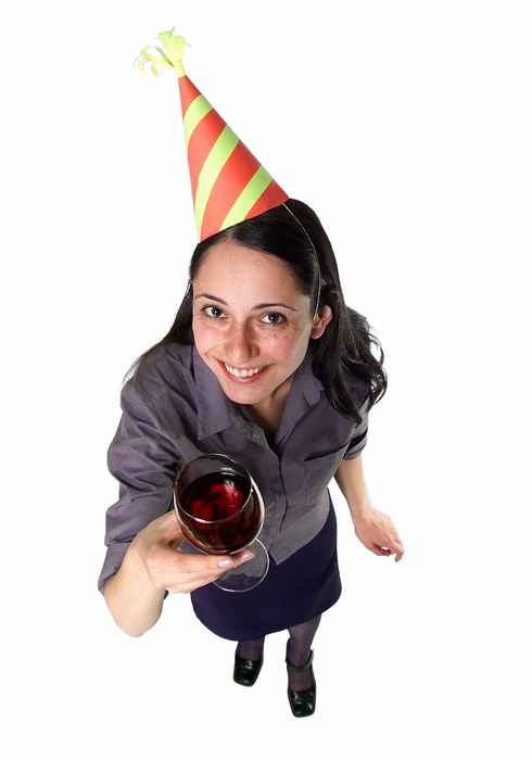 Woman Celebrating with Glass of Red Wine
