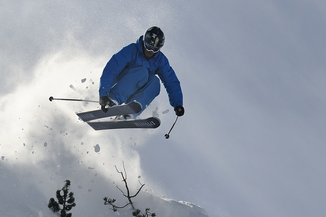 Skier Jumping in Air on slopes