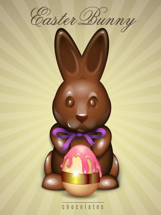 Chocolate Easter Bunny holding a candy egg